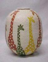 Giraffe Surround this Pot