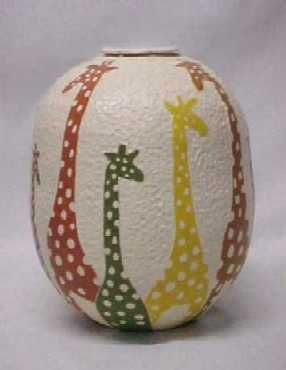 Giraffe Surround this Pot